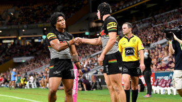 Matt Burton and Brian To'o shake hands after a try against Brisbane last week.