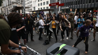 Protesters danced at each intersection as the Reclaim the Streets and Keep Sydney Open march made its way through the city streets.