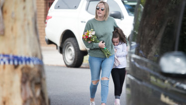 Mourners leave tributes at the family's Tullamarine home on Friday.