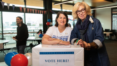 Down Under Democrats Kristen Gordon (left) and and Laurie Staub at the polling booth in Docklands on Saturday.