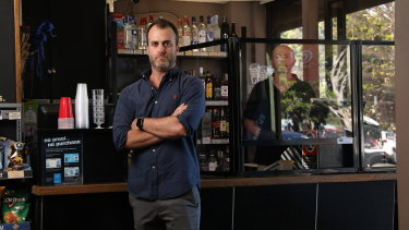David Silverton, co owner of Portable Partitions Australia, at Balmoral Cellars where a screen has been installed to protect workers from coronavirus