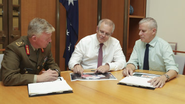 Mr Morrison meeting with National leader Michael McCormack and national drought coordinator Major General Stephen Day.
