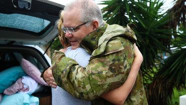 Mr Morrison is seen hugging a Townsville resident.