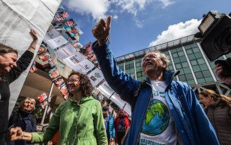 Environmental activists celebrated the verdict in the case against Shell in the Hague.