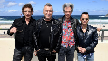 Australian rock icons Cold Chisel - Ian Moss, Jimmy Barnes, Don Walker and Phil Small - at Bondi Beach.
