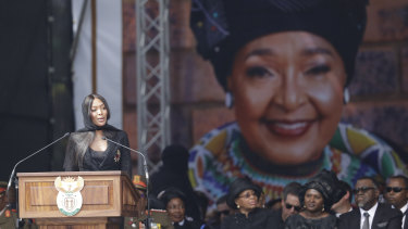 British model Naomi Campbell pays tribute at the funeral of struggle icon Winnie Madikizela-Mandela, at the Orlando Stadium in Soweto, South Africa, Saturday, April 14, 2018.