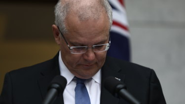 Moved to tears: The Prime Minister at Parliament House yesterday.