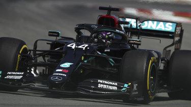 Lewis Hamilton steers his car during practice.