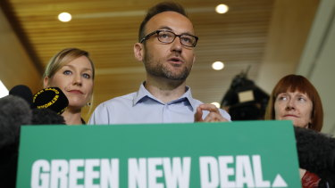 New Greens leader Adam Bandt, pictured with co-deputy leader Larissa Waters, wants to impose a new levy on coal companies to pay for more firefighters.