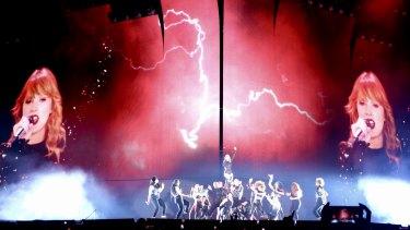 Swift balances anthemic, empowering bombast with intimate acoustic moments.