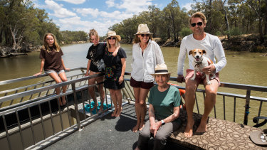 The Meagher family on board their plan B holiday accommodation, a boat on the Murray.