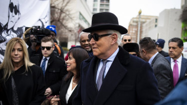 Roger Stone, former adviser to Donald Trump's presidential campaign, centre, and his wife Nydia Stone, left, at federal court in Washington, DC.