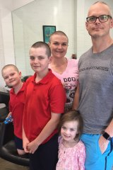 The family that shaves together, stays together, generous-hearted Annabelle Wright (left) aged eight who shaved her hair for the Leukaemia Foundation's World's Greatest Shave on March 14. She also persuaded mum Cristy, dad David and brother Oliver to do the same. They are pictured with Annabelle's little sister Alice, four.