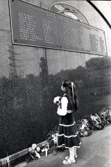 On the day the bridge opened, Christine Fitzsimmonds, 9, stood before the memorial plaque at the base of the bridge and wiping a tear from her eye, laid a floral tribute to her father, Bernard, one of 35 men who died in the disaster.