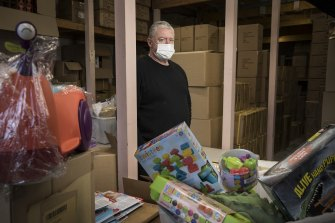 Toy importer Peter O'Brien, of New Dimension Oz, in his warehouse.
