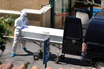 A coffin is carried out from the health care residence and hospice San Raffaele, that was cordoned off after some 80 people tested positive and two died, in Rocca di Papa, near Rome, on Wednesday.