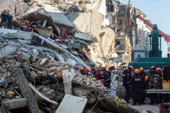 Rescue workers search for earthquake survivors in the Turkish city of Elazig on Sunday.