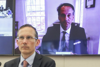 ASIC chair James Shipton appearing via teleconference on Friday, and Labor MP Andrew Leigh (in foreground).