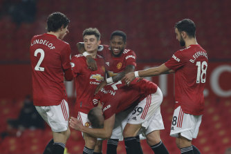 United celebrate Scott McTominay's 71st-minute goal.