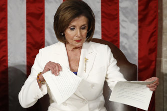 Nancy Pelosi tears up her copy of Donald Trump's State of the Union speech.