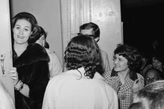 Joan Sutherland greets fans at she enters by the stage door at Her Majesty's Theatre.