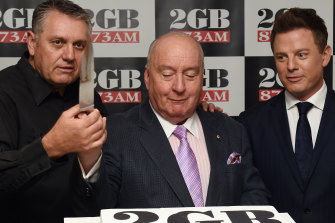 You call that a knife? Ray Hadley, Alan Jones and Ben Fordham cut a cake in 2014 to celebrate 2GB's 10 straight years with 80 consecutive ratings wins.