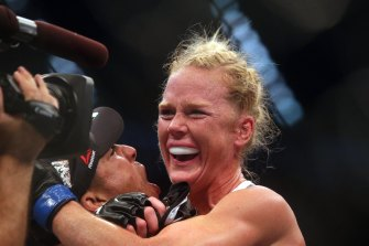 Holly Holm celebrates after her spectacular win over Ronda Rousey in Melbourne in 2015.