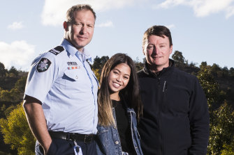 First responders ACT Policing search and rescue coordinator Lachlan Ryan and former ACT Parks area manager Tim Chaseling with Kathleen Bautista at the site of the crash.