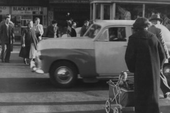 """""""If the campaign can save only one or two lives, it will be worthwhile."""" Pedestrian crossing, Taylor Square, June 22, 1956."""