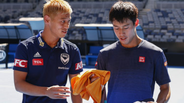 Lone star: Melbourne Victory's Japanese marquee Keisuke Honda , pictured at the Australian Open with countryman Kei Nishikori on Friday - is the only Asian player in the A-League.