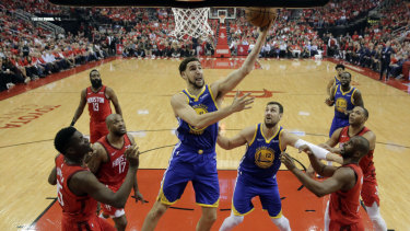 Andrew Bogut (centre right) relished the series win over Houston.