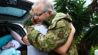 Mr Morrison is seen hugging a Townsville resident.