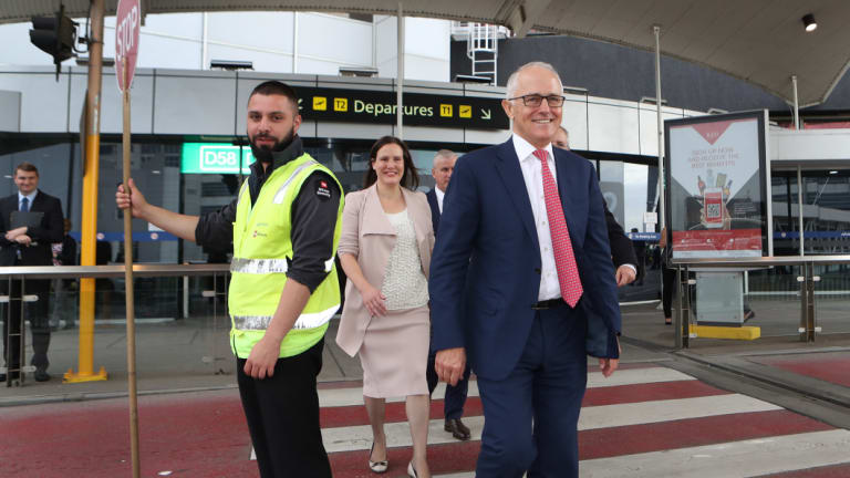 Prime Minister Malcolm Turnbull and Revenue and Financial Services Minister Kelly O'Dwyer arrive for a press conference at Melbourne Airport on Thursday.
