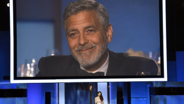 George Clooney crying in response to his wife's speech.