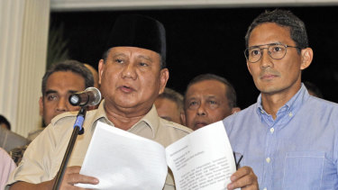 Losing presidential candidate Prabowo Subianto, left, speaks to reporters as his running mate Sandiaga Uno listens during a press conference in Jakarta, Indonesia.