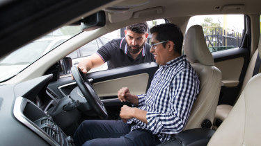 Customer Miguel Mendoza getting instructions for a test drive from ANS Car Sales dealer Bill Assaad.