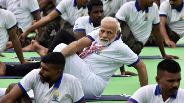 Indian Prime Minister Narendra Modi gets into a twist in Ranchi on Friday.