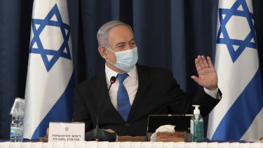 Benjamin Netanyahu wears a face mask to help prevent the spread of the coronavirus as he chairs the weekly cabinet meeting.