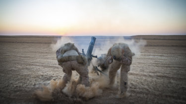 US Marines fire mortars from an undisclosed location in Syria before US President Donald Trump declared the Islamic State group defeated.