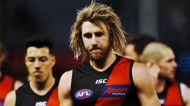 Dyson Heppell leads the Bombers from the field after their abysmal loss to the Western Bulldogs.