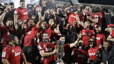 Spoils to the winners: The Crusaders celebrate their remarkable ninth Super title.