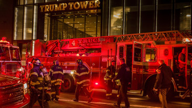 Firefighters outside Trump Tower on Saturday evening.