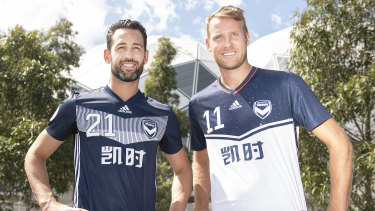 Victory captain Carl Valeri and teammate Ola Toivonen pose in the club's playing strip for the Asian Champions League.