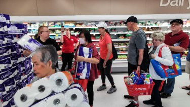 Australians rushed into supermarkets to hoard supplies in the coronavirus crisis.