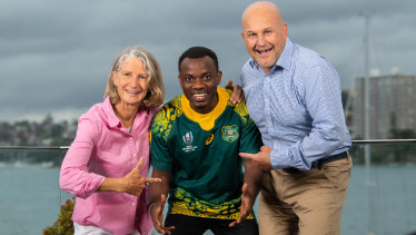 Burundian refugee David Nduwimana with Rugby Australia interim CEO Rob Clarke and wife Kylie Virtue-Clarke.