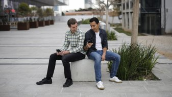 Brothers Igor, right, and Dmitri Bukhman are the brains behindPlayrix, the creator of popular games similar to Candy Crush, including Fishdom and Gardenscapes.
