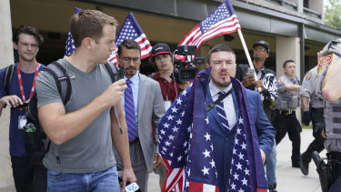 White supremacist Jason Kessler arrives at the Vienna metro station to travel to Washington on the first anniversary of their rally in Charlottesville.