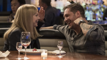 Michelle Williams as Anne Weying and Tom Hardy as Eddie Brock.