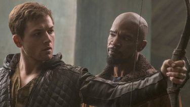 Taron Egerton, left, and Jamie Foxx in the 2018 film Robin Hood.