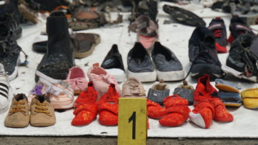 Baby shoes among the debris and personal belongings fished out of the sea by search and rescue teams and lined up at Tanjung Priok crisis centre after the crash of Lion Air flight JT610.